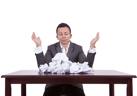 Image of a young businessman with crumpled papers on his desk Banco de Imagens