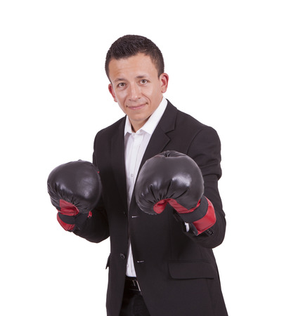 Young mixed race businessman with boxing gloves posing against white Banco de Imagens