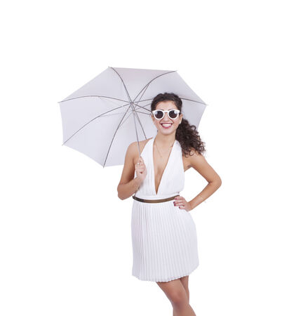 Attractive young woman with umbrella posing against white background Banco de Imagens