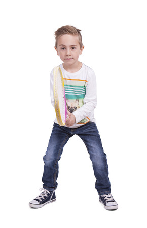Portrait of a adorable boy posing with a tennis racket posing against white background