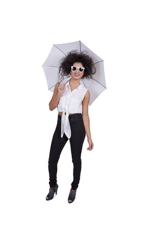 Image of an attractive young female posing with umbrella and sunglasses