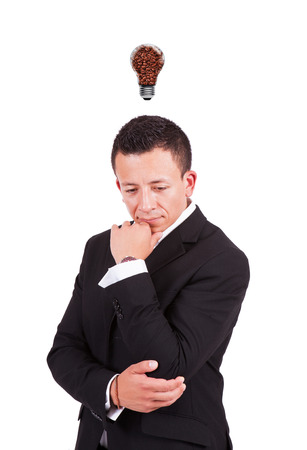 Businessman with coffee bulb over his head photo