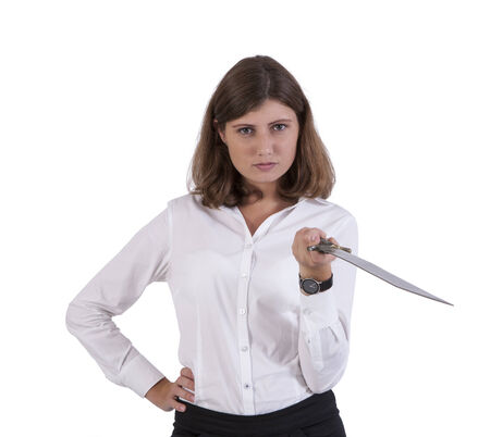 Portrait of a serious young businesswoman posing with a sword Banco de Imagens