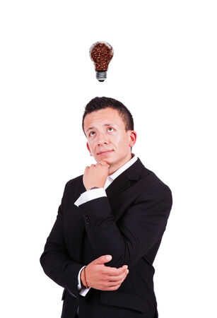 Businessman looking at coffee bulb over his head photo