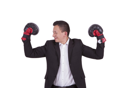Young businessman with boxing gloves flexing biceps