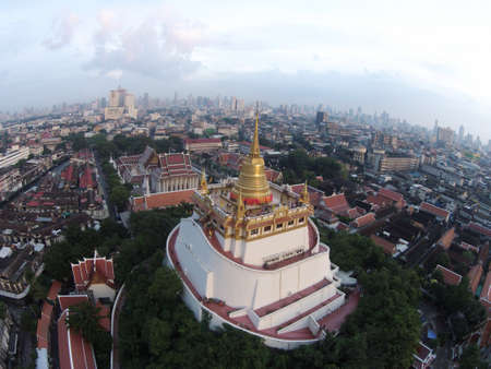 gold: Temple Gold Mountain at Bangkok Thailand beautiful and famous for tourist unusually To be seen in bird eye view. Stock Photo