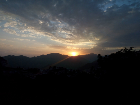 Scenery of Clouds, mountains and sky in the evening time in the hills Uttarakhand