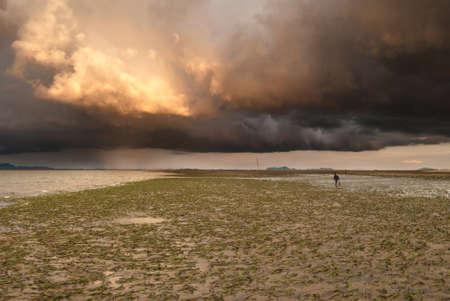 A brewing storm on an ocean sunset