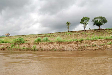 Eroded cut bank of Mae Khong river, Thailand photo