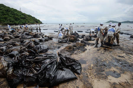the desolate: crude oil on oil spill accident on Ao Prao Beach at Samet island on July 31,2013 in Rayong,Thailand