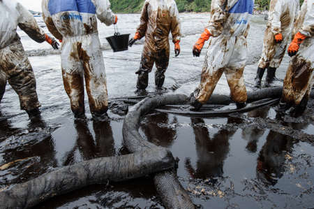 oil spill: crude oil on oil spill accident on Ao Prao Beach at Samet island on July 31,2013 in Rayong,Thailand
