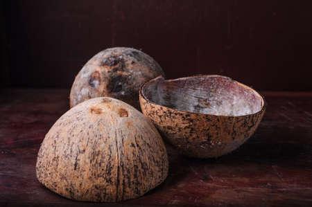 Coconut shells on dark backgroud photo