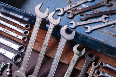 Dirty set of Wrench on a tool boxvintage background with a tools