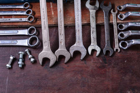 Dirty set of Wrench on a wood platform/vintage background with a tools photo