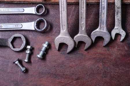 Dirty set of Wrench on a wood platformvintage background with a tools Stock Photo