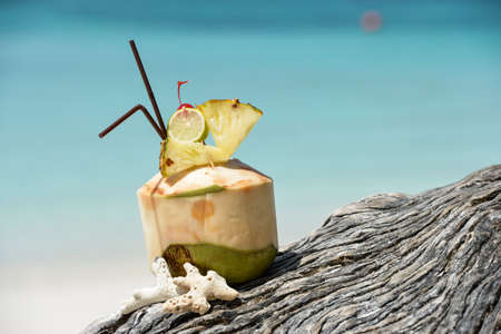 Coconut with drinking  at the sea Stock Photo