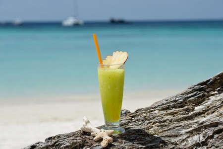 Fresh fruit cocktail juice on the beach