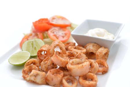 Deep Fried Calamari Rings with Sauce Bowl Stock Photo