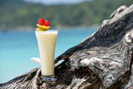 Milk cocktail on wood at beach - vacation background photo