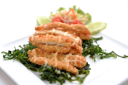 Chicken crumbed breast with cream photo