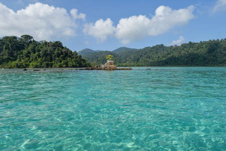 stormy waters: tropical beach with jungle, Andaman Sea, Thailand Stock Photo