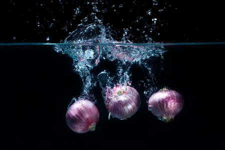 Shallots Vegetables, dropped in fresh water Stock Photo