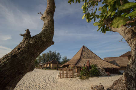 Cafe and restaurant on a tropical beach - travel background