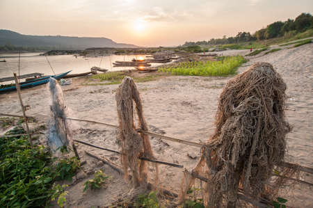 occur: Photography of fishing boats on the mekong river with dawn at Khong Chiam, Ubon Ratchathani,Thailand
