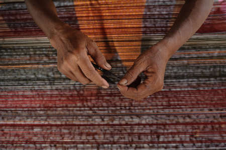 weaving: People are silk weaving in Thailand