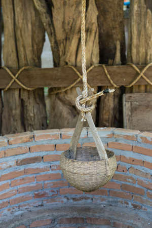 dug well: Ancient Water well and old water dipper made from bammboo