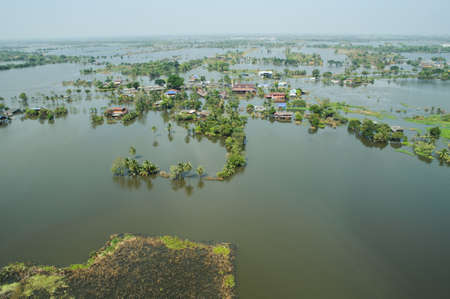 overtake: Flood waters overtake a city in Thailand form above view