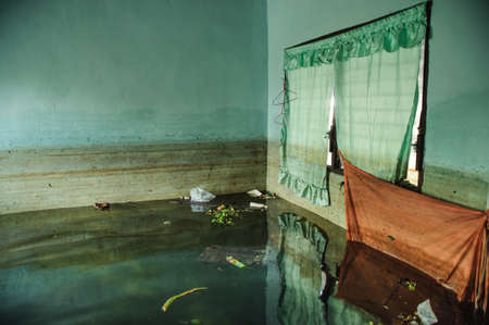 Flood Natural Disaster - Old Living Room Destroyed From Flood, Thailand Stock Photo