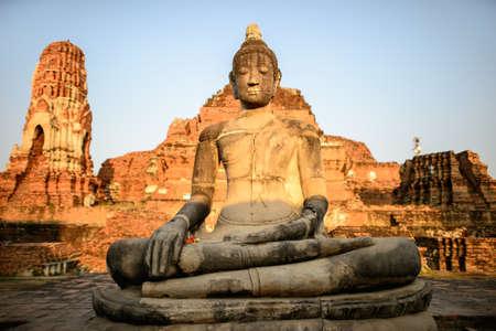 religious art: Asian religious art. Ancient sandstone sculpture of Buddha at ruins. Ayutthaya, Thailand