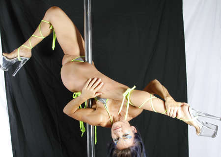 upside down: Pole Acrobat Stock Photo