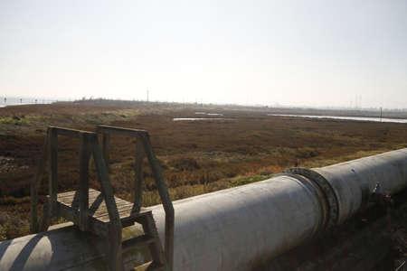 overbridge: Industrial zone - water pipelinew Stock Photo