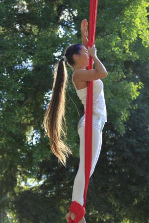 Acrobat in a park