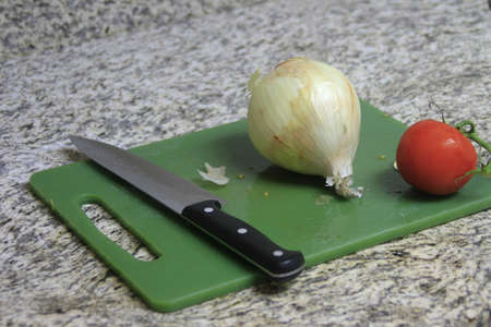 ead: Onion and Tomato on cutting board