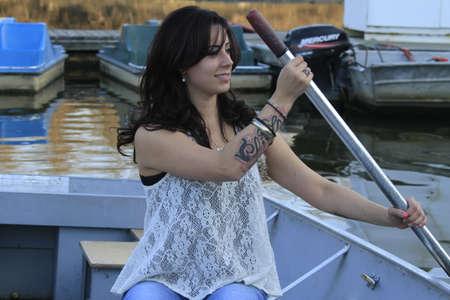 Meisje in een boot  Stockfoto