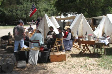 Civil War Reenactment; people talking, chatting, eating