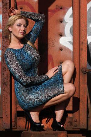Photo shoot of a model at a railway yard photo