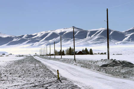 telephone poles: Southern Idaho in winter - Sun Valley, Craters of the moon, Telephone poles strung along road, Stock Photo