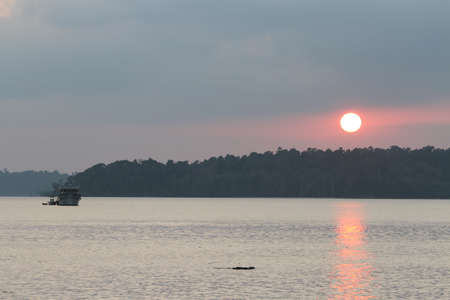 warm water: beaches at the andamans, white sand and warm water; Sunset over the beach Stock Photo