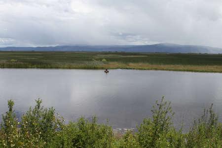 wildlife preserve: View of a man fishing in a lake at klamath falls wildlife preserve