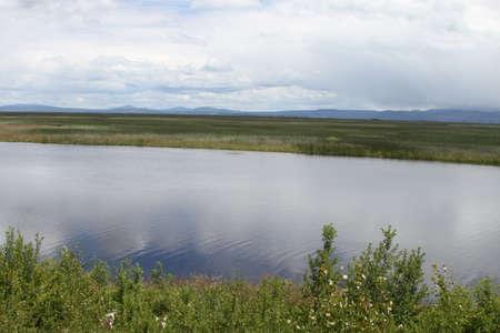 klamath: View of a man fishing in a lake at klamath falls wildlife preserve