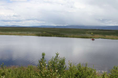 wildlife preserve: View of a man fishing in a lake at klamath falls wildlife preserve