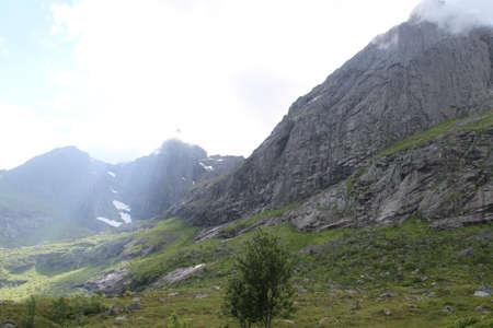 Lofoten peninsula, Norway, Mountains, lakes, and fjords Редакционное