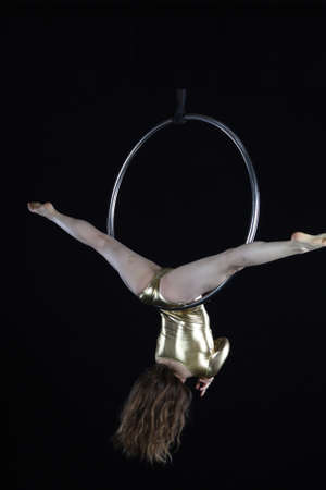 Photoshoot of a acrobat model, doing contortion, rings and aerial gymnastics Stock Photo