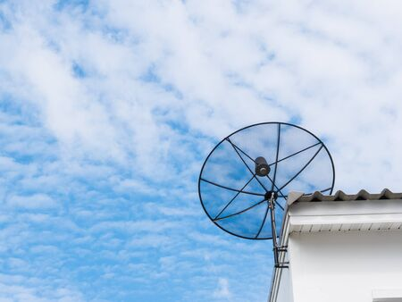 roof top: Satellite dish on roof top. Stock Photo