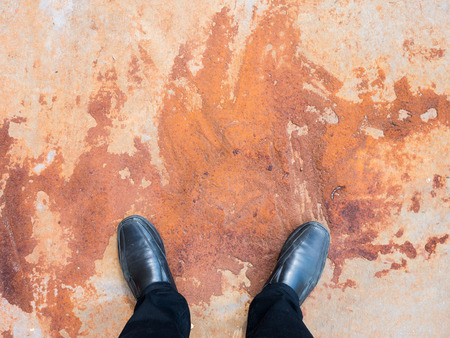 oxidize: Business man looking down to the rusty steel floor. Stock Photo