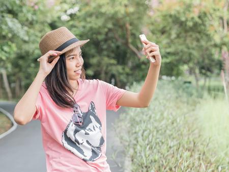 mirthful: Asian girl taking her self photo.